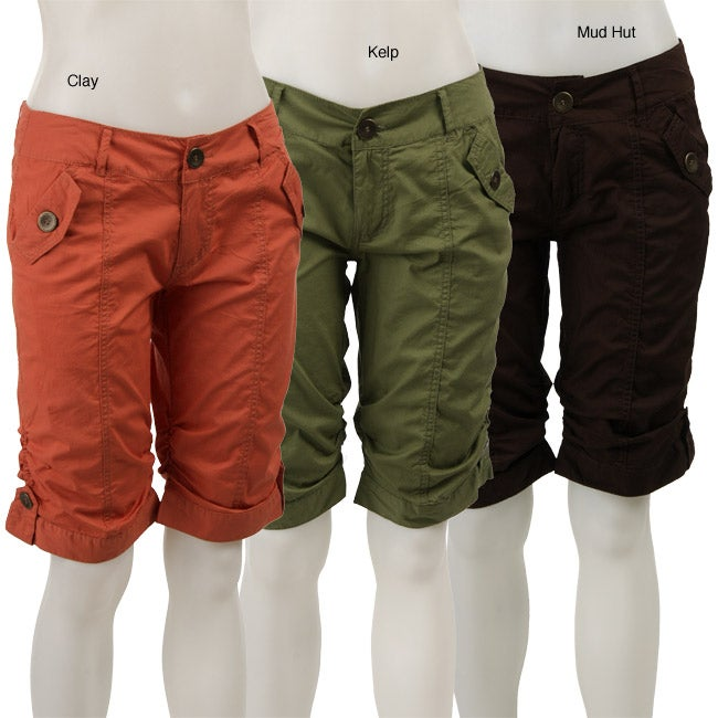 The length of these women's bermuda shorts falls just above the knee, accompanied by longer inseams deliver extra comfort. Attached loops help secure the belting accessory of your choice. Pair them with a mod top and bright snazzy sandals for a pop of color at your next outdoor picnic or soiree.