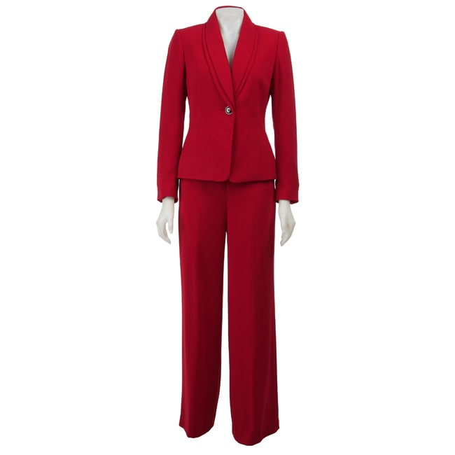 The vest and pant suit shown with the tie is cut from an Italian superfine wool with brown gabardine pants and contrast details and a tuxedo stripe on the pants. The shirt is a fitted due-bottoni collar shirt with french cuffs (yes we make women's dress shirts also) in a dobby weave.
