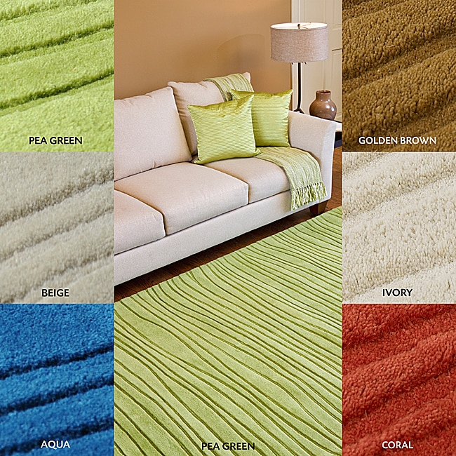 Hand-tufted Solid Beige Casual Groovy Wool Rug (9' x 13')