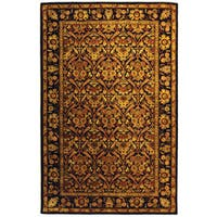 Safavieh Handmade Treasured Dark Plum Wool Rug - 5' x 8'