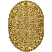 Safavieh Handmade Classic Kasha Gold Wool Rug - 7'6' x 9'6' oval