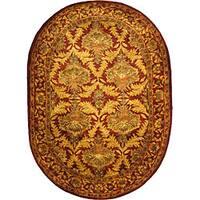 "Safavieh Handmade Kerman Wine/ Gold Wool Rug - 4'6"" x 6'6"" oval"