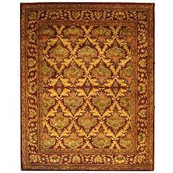 Safavieh Handmade Kerman Wine/ Gold Wool Rug (7'6 x 9'6)