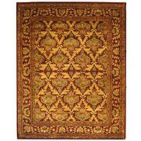 Safavieh Handmade Kerman Wine/ Gold Wool Rug - 7'6 x 9'6