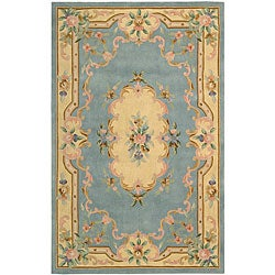 Nourison Hand-tufted Light Blue Floral Wool Rug (7'3 x 9'3) - Thumbnail 0