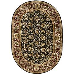 "Safavieh Handmade Classic Dark Olive/ Red Wool Rug - 4'6"" x 6'6"" oval - Thumbnail 0"