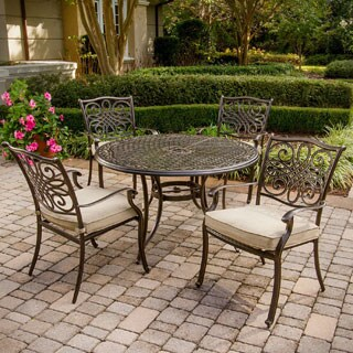 piece outdoor dining set with 4 aluminum cast chairs and 48 inch round