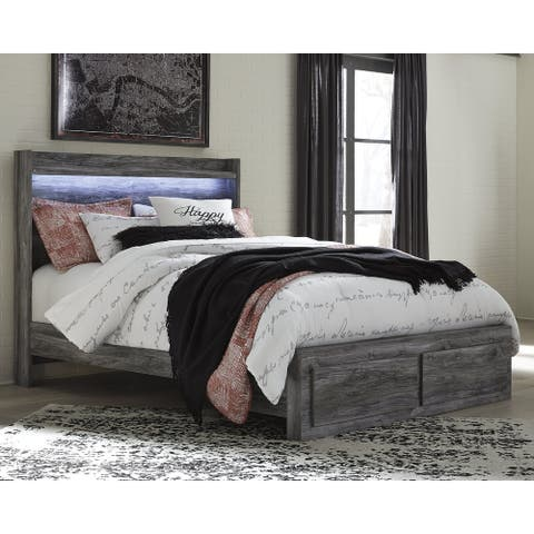 Baystorm Weathered Gray Panel Bed with Footboard Storage Drawers