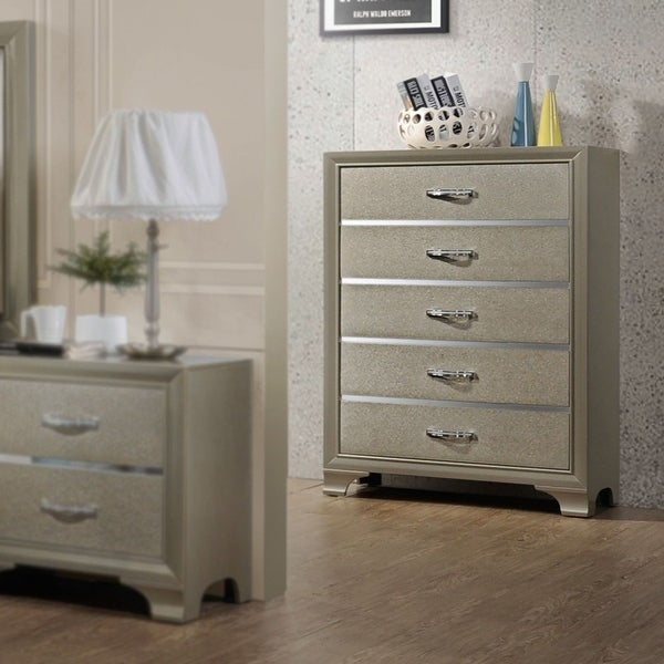 Contemporary 5 Drawer chest-Champagne finish. Opens flyout.