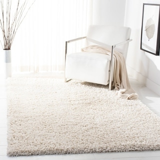Link to SAFAVIEH August Shag Veroana Solid 1.5-inch Thick Rug Similar Items in Living Room Furniture