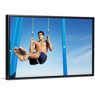 """""""Man on a beach working out on exercise rings apparatus"""" Black Float Frame Canvas Art"""