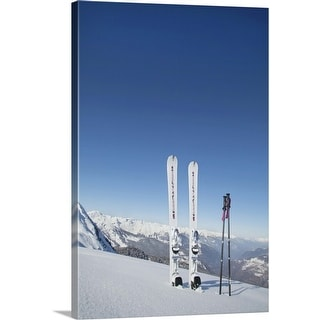 """Skis and ski poles stuck in the snow"" Canvas Wall Art"