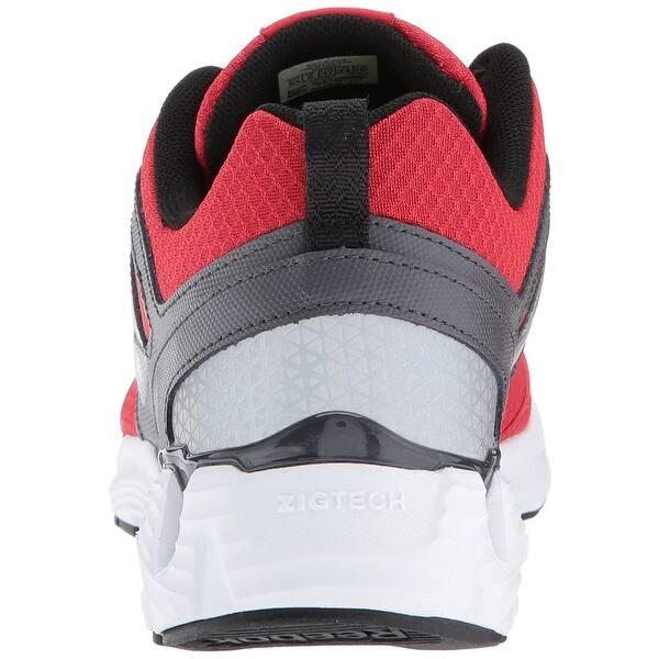 d3e1390f8d Shop Reebok Unisex-Kids Zigkick 2K17 Sneaker, Red, Size 7 Child US ...