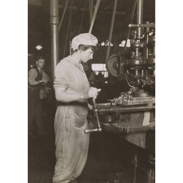 Shop Women At A Long Bench Working On Engine Parts At A Lincoln