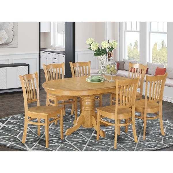 7-piece Formal Oval Dinette Table with Leaf and 6 Dining Chairs - Oak. Opens flyout.