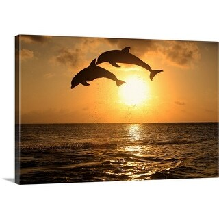Premium Thick-Wrap Canvas entitled Bottle-nosed dolphins leaping in front of a sunset - Multi-color