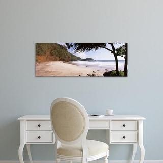 Easy Art Prints Panoramic Images's 'Tree on the beach, Lelekea Beach, Hana, Maui, Hawaii, USA' Premium Canvas Art