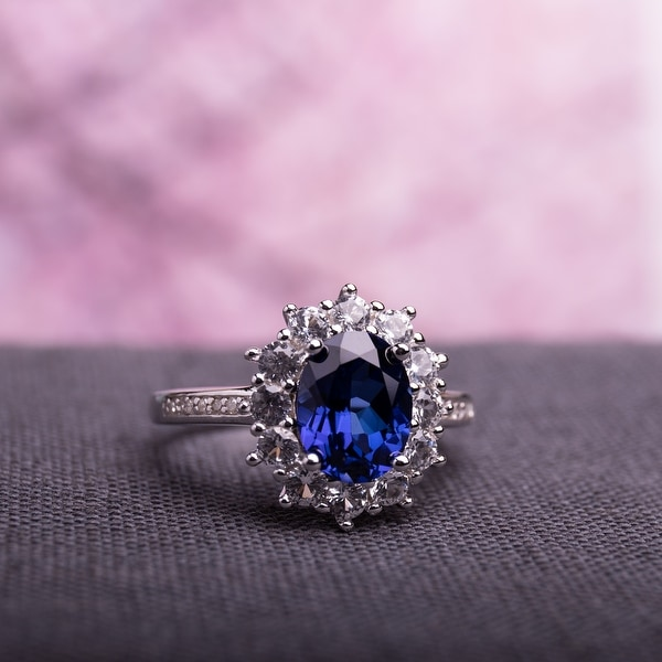 4ct TGW Created Blue and White Sapphire Diamond Halo Ring in Sterling Silver by Miadora. Opens flyout.