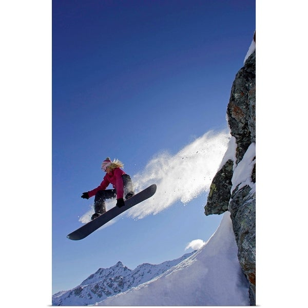 """""""Female snowboarder jumping off a rock"""" Poster Print"""
