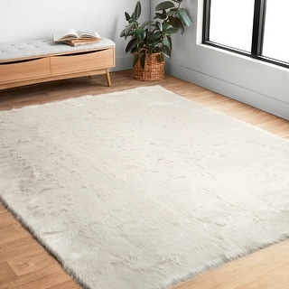 Link to Strick & Bolton Newport Faux Sheepskin Ivory White Shag Area Rug Similar Items in Shag Rugs