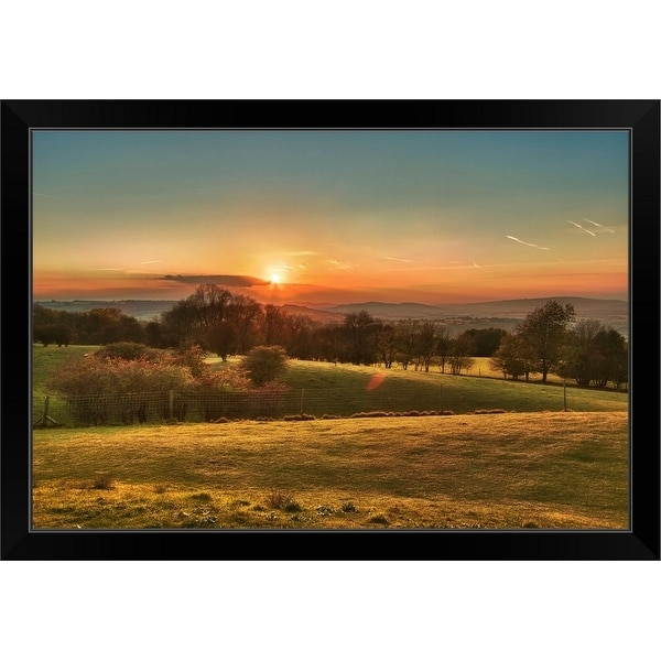 """Trees in line against fence at sunset in Broadway, Worcestershire."" Black Framed Print"