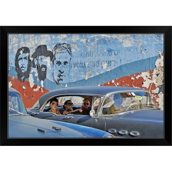 """People in vintage American cars and murals of the Cuban Revolution"" Black Framed Print"