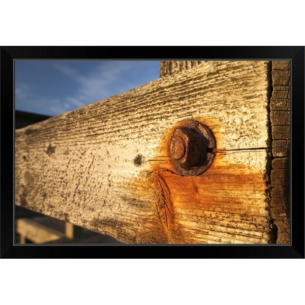 """Nut and bolt on a weathered wood wall"" Black Framed Print"