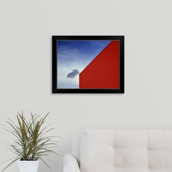 """A shadowed cloud floating through blue sky over the red corner of James John School."" Black Framed Print"