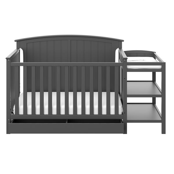 Storkcraft Steveston 4-in-1 Convertible Crib and Changer - 2 Open Shelves, Water-Resistant Vinyl Changing Pad with Safety Strap. Opens flyout.