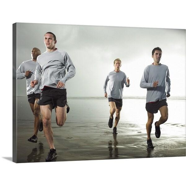 """""""Four men running on beach by ocean"""" Canvas Wall Art"""