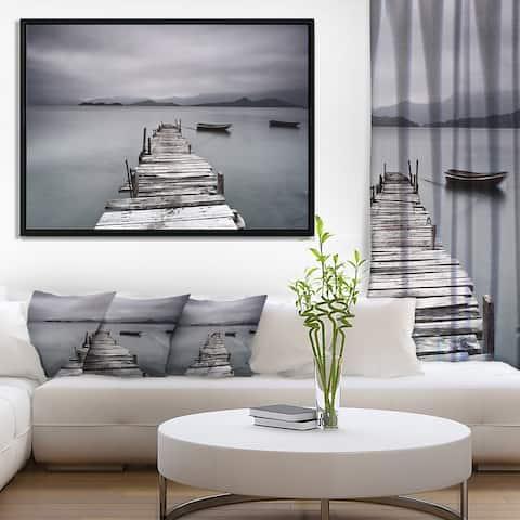 Designart 'Pier and Boats at Seashore' Bridge Framed Canvas Art Print