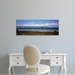 Easy Art Prints Panoramic Image 'Bridge across lake, Mackinac Bridge, Lake Michigan, Mackinaw, Michigan' Canvas Art