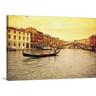 Premium Thick-Wrap Canvas entitled A gondola in a canal, Rialto Bridge, Venice, Italy