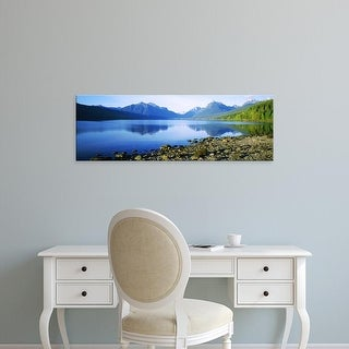 Easy Art Prints Panoramic Image 'Reflection of rocks in lake, McDonald Lake, Glacier National Park, Montana' Canvas Art