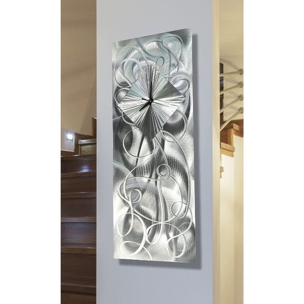 "Statements2000 Silver Metal Wall Clock Art Modern Silver Accent Decor by Jon Allen - Light Source Clock - 24"" x 10"". Opens flyout."