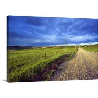"""Dirt road through farmland, distant storm clouds, Missouri Breaks, Montana"" Canvas Wall Art"