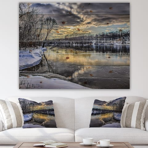 Designart 'Delicate Sunshine Reflected On Winter River In The Woods' Traditional Print on Natural Pine Wood