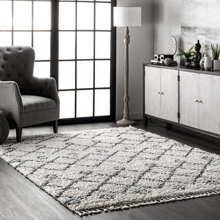 Link to The Curated Nomad Dennis Hollow Geometric Trellis Tassel Shag Area Rug Similar Items in Casual Rugs