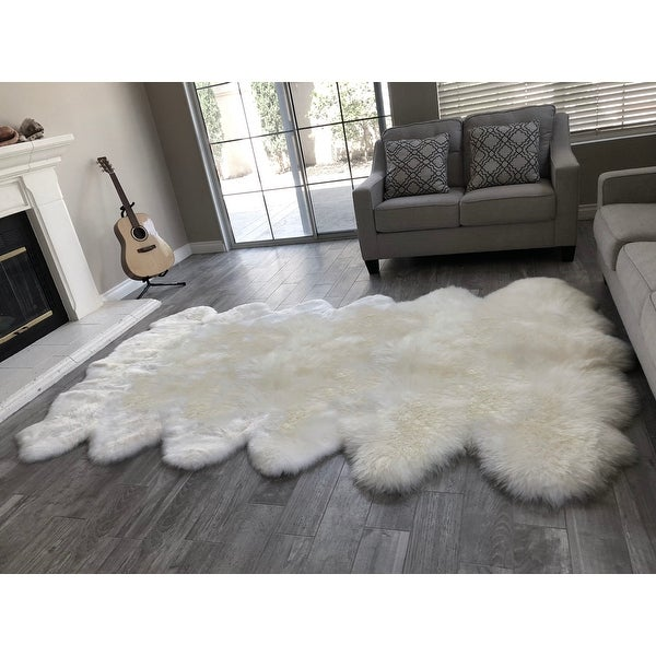 "Dynasty Natural 12-Pelt Luxury Long Wool Sheepskin Shag Rug - 5'5"" x 9'2"". Opens flyout."