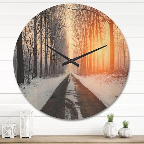 Designart 'Bright Sun Break in Winter Forest ' Farmhouse Wood Wall Clock