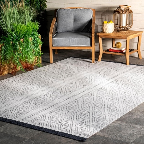 The Curated Nomad Frida Indoor/ Outdoor Geometric Striped Tassels Area Rug. Opens flyout.