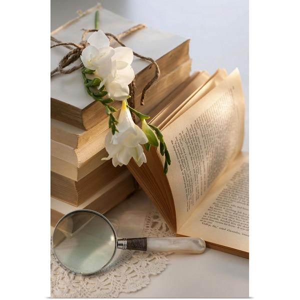 """""""Magnifying glass beside stack of books with flowers"""" Poster Print"""