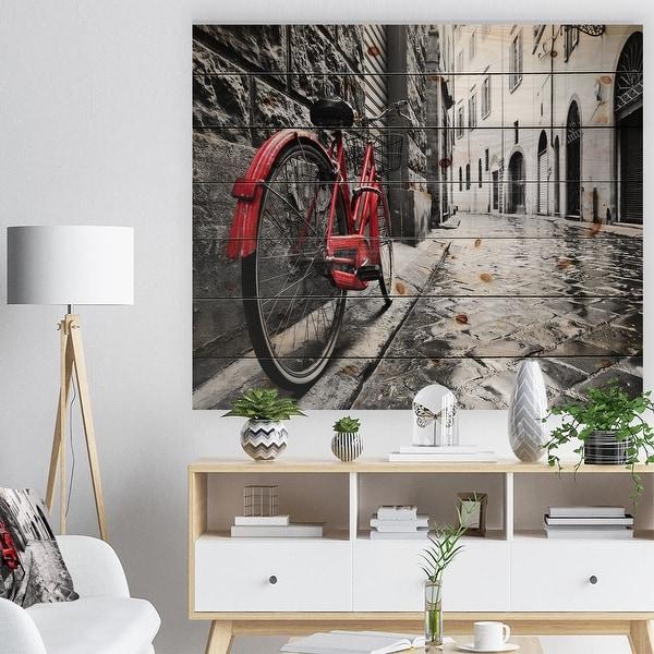 Designart 'Retro Vintage Red Bike' Cityscape Photo Print on Natural Pine Wood - Black. Opens flyout.