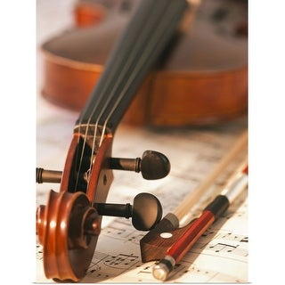 """""""Close up of violin scroll and bow on sheet music"""" Poster Print"""