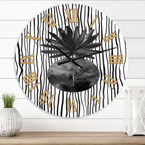 Designart 'Black and White Tropical Leaf On Striped I' Modern wall clock