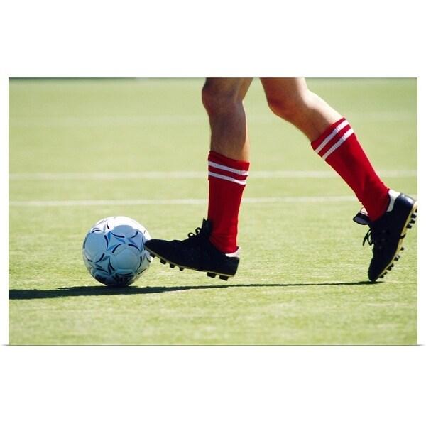 """Feet of soccer player kicking ball"" Poster Print"
