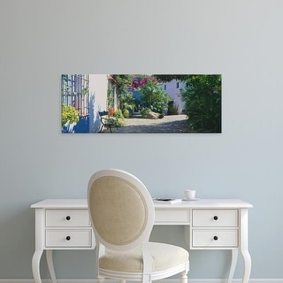Easy Art Prints Panoramic Image 'Plants, House, Marbella, Costa del Sol, Malaga Province, Andalusia, Spain' Canvas Art