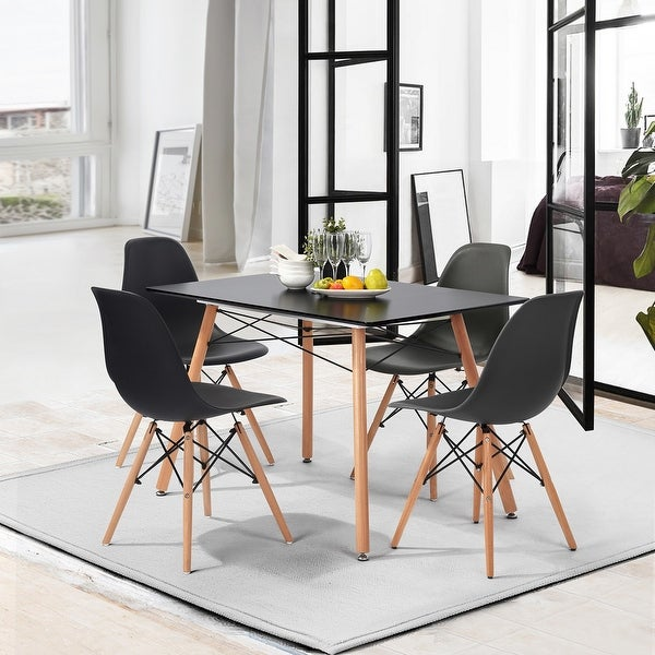 Carson Carrington Mid-Century Modern Spoon Dining Chair (Set of 4). Opens flyout.