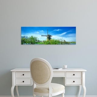 Easy Art Prints Panoramic Images's 'Windmill in a village, Kinderdijk, North Holland, Netherlands' Premium Canvas Art