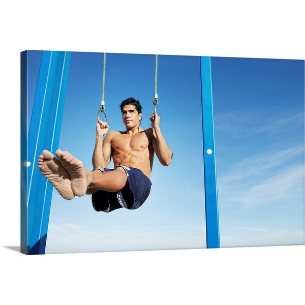"""""""Man on a beach working out on exercise rings apparatus"""" Canvas Wall Art"""